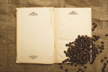 Coffee beans and open book