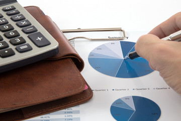 Businessman's hand showing diagram on financial report