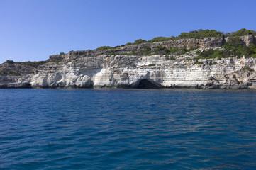 Natural caves on the coast of Menorca, Mediterranean sea, Spain.