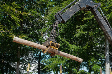 Heavy harvester loader doing forestry work