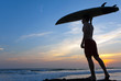 Man surfer with surfboard on a coastline. Bali. Indonesia