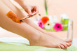 Woman in Spa getting leg waxed for hair removal