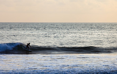 Surfer on Blue Ocean Wave in Bali, Indonesia