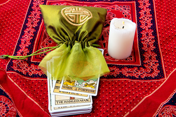 Tarot cards and burning candle