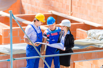 Team discussing construction or building site plans