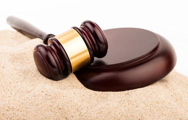 law gavel on sand