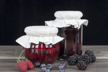 jar of homemade jam and fresh fruits