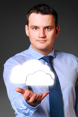 businessman is holding clouds