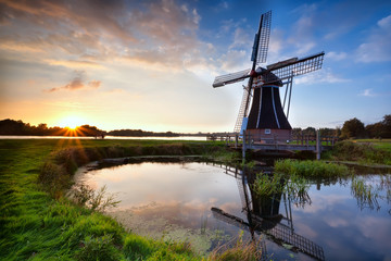 charming Dutch windmill at sunset