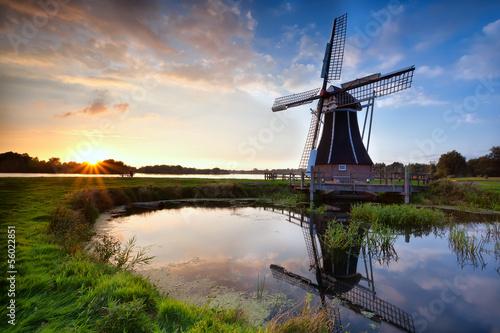 charming Dutch windmill at sunset - 56022851