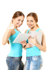Two smiling women holding tablet computer