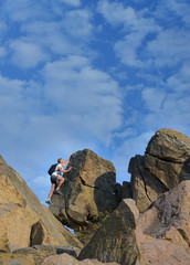 Man climbing a high rock face