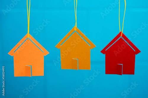 Three colored toy houses