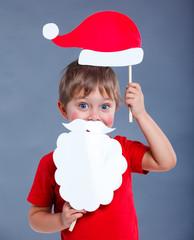 Little boy in Santa hat.