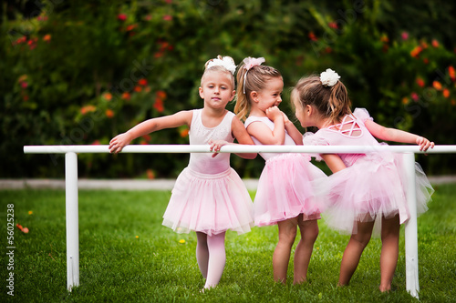 Foto op Canvas Dance School Group of little girls doing ballet bar exercises