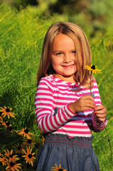 adorable girl with a flower