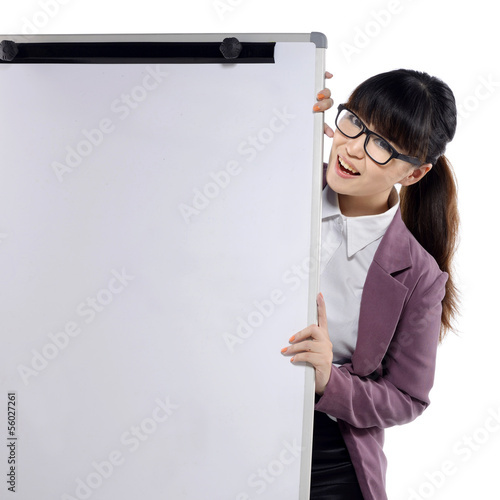 Young attractive business woman standing with a flipchart