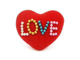 Red heart with pinned love on white background