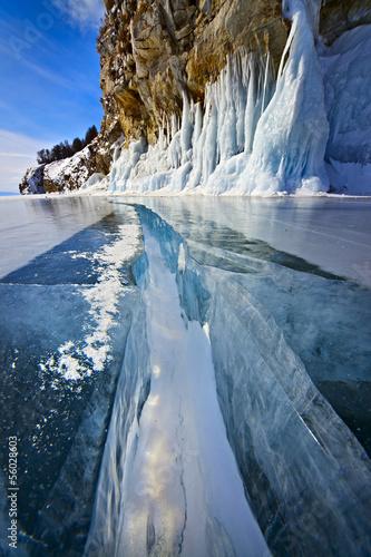 Leinwanddruck Bild Wide crack through thick ice