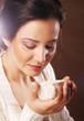 Beautiful girl drinking tea or coffee.