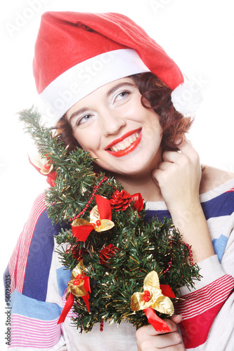 Santa woman holding tree