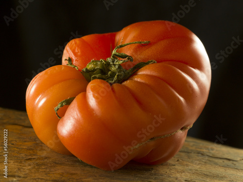 a strange tomato in an artistic way