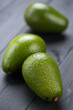 Close-up of avocado pears on black wooden boards