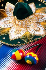 Multicolored mexican maracas, sombrero and poncho