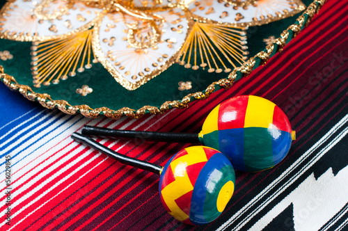 Two wooden maracas, poncho and sombrero, studio shot