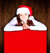 christmas girl holding banner over wooden background