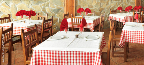 dressed tables in an old rustic restaurant