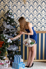 girl dresses up Christmas tree
