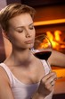 Attractive woman smelling glass of wine