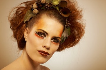 Beauty shot woman in autumn makeup
