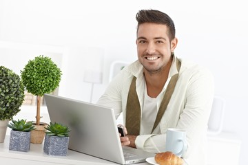Happy businessman in the morning