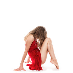 Modern style dancer in red dress posing in studio, isolated