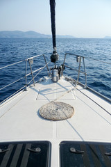 On the bow of a sailing yacht, in Greece