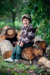 Boy sitting on a wooden trunk