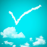 check mark cloud in a blue sky