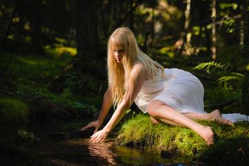 Woman on creek