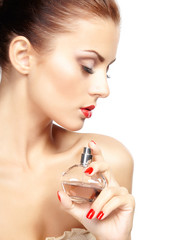 Young woman applying perfume on herself isolated on white backgr