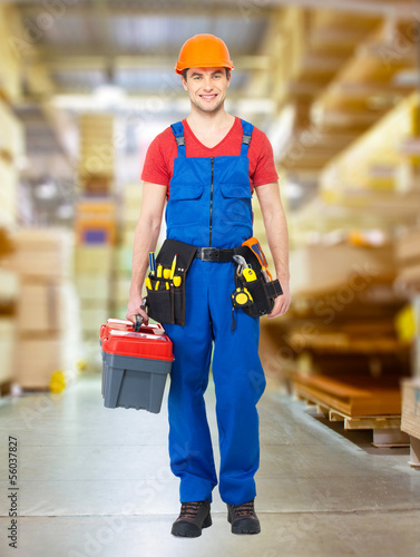 Handyman with tools full portrait