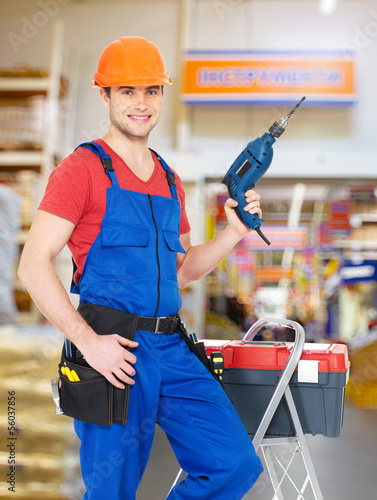 manual worker with tools at warehouse