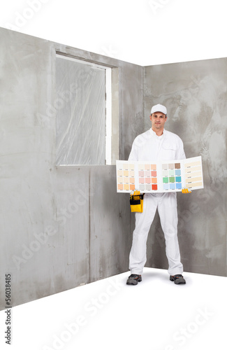 Worker holding a colour samples palette