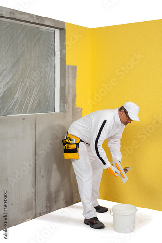 Worker in front of plastered wall