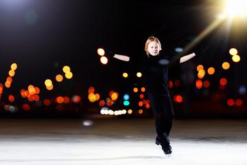 Young boy figure skating