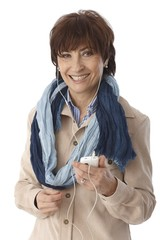 Happy elderly woman with mp3 player