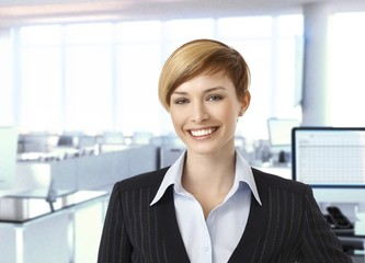 Happy businesswoman in corporate office