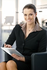 Mid-adult businesswoman working with tablet