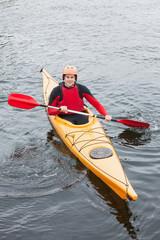 Happy man in a kayak